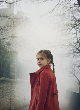 Mark Owen LITTLE GIRL WITH COAT IN FOGGY PATHWAY Children