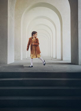 Mark Owen LITTLE GIRL RUNNING INSIDE ARCHED BUILDING Children
