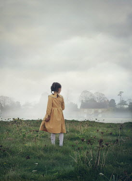 Mark Owen LITTLE GIRL IN FOGGY FIELD WATCHING HOUSE Children