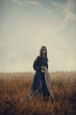 Magdalena Russocka historical woman standing in meadow