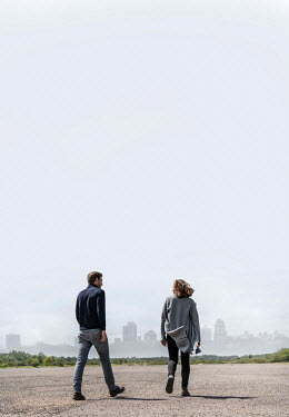 CollaborationJS COUPLE WALKING OUTDOORS WITH CITY SKYLINE Couples