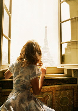 CollaborationJS WOMAN SITTING BY WINDOW WATCHING EIFFEL TOWER Women
