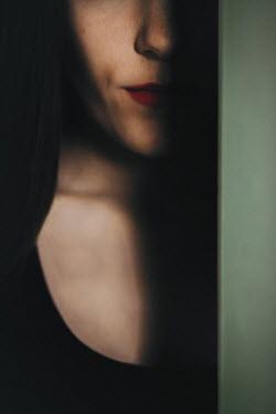 Ildiko Neer Close up of woman behind door