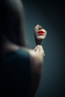 Ildiko Neer Woman's red lips reflecting in broken mirror