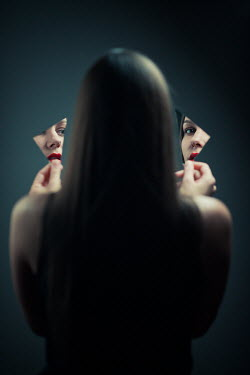 Ildiko Neer Woman's face reflecting in two pieces of broken mirror
