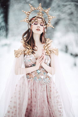 Jovana Rikalo WOMAN WITH GOLD CROWN PRAYING IN SNOW Women