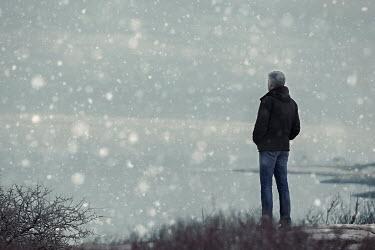 Lisa Bonowicz MAN STANDING WATCHING LAKE IN SNOW Men