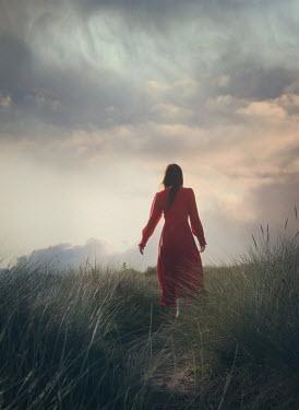 Mark Owen BRUNETTE WOMAN WALKING IN SAND DUNES Women