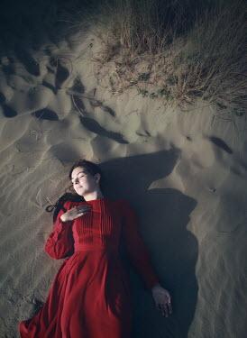 Mark Owen WOMAN IN RED DRESS LYING ON BEACH IN SHADOW Women