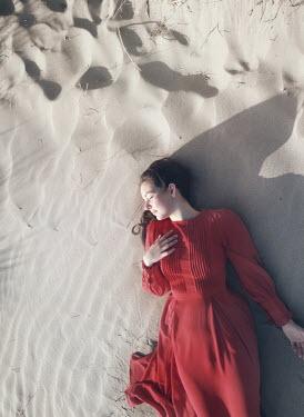 Mark Owen GIRL IN RED DRESS SLEEPING ON SANDY BEACH Women