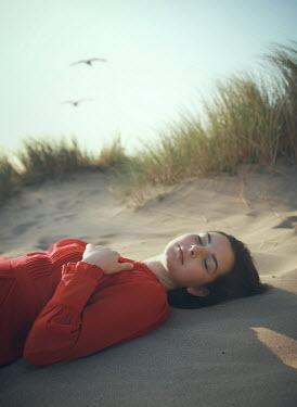 Mark Owen WOMAN IN RED DRESS SLEEPING IN SAND DUNES Women