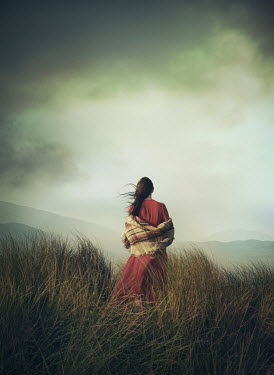Mark Owen WOMAN WITH SHAWL IN FIELD WATCHING MOUNTAINS Women