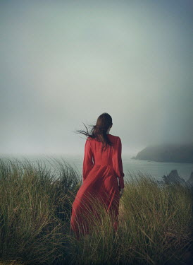 Mark Owen WOMAN WITH RED DRESS IN DUNES WATCHING SEA Women