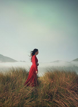 Mark Owen WOMAN WITH RED DRESS IN DUNES BY SEA Women