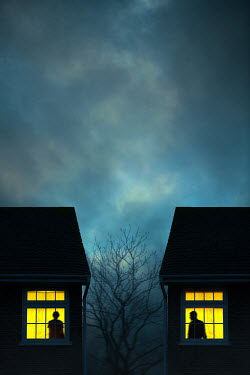 Magdalena Russocka man and woman in windows of two houses at night
