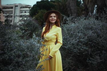 Katerina Klio WOMAN IN HAT STANDING IN CITY PARK Women
