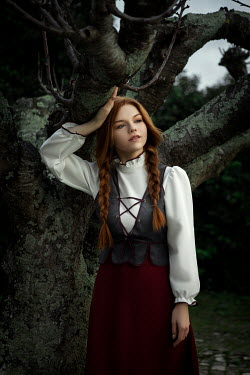 Katerina Klio WOMAN WITH RED HAIR LEANING ON TREE Women