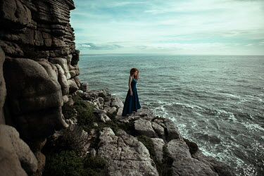 Katerina Klio WOMAN WITH RED HAIR ON ROCKS WATCHING SEA Women