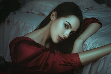 Katerina Klio BRUNETTE WOMAN IN RED LEANING ON BED Women