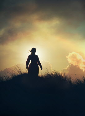 Mark Owen SILHOUETTED WOMAN IN DUNES WATCHING SUNSET Women