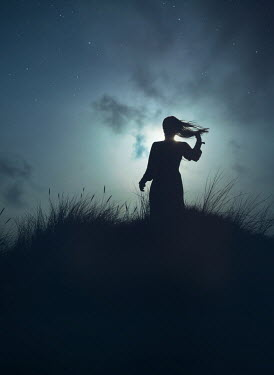 Mark Owen SILHOUETTED WOMAN IN DUNES WATCHING MOONLIGHT Women