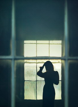 Mark Owen SILHOUETTED WOMAN INSIDE HOUSE BY WINDOW Women