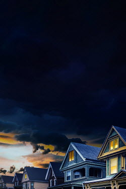 Sandra Cunningham Roof tops of houses with storm clouds in the distance