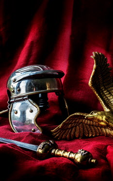 Stephen Mulcahey GOLDEN ROMAN HELMET SWORD AND EAGLE ON RED CLOTH Miscellaneous Objects
