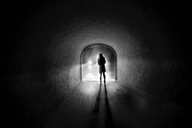 Terry Bidgood SILHOUETTED WOMAN IN TUNNEL WITH LIGHTS Women