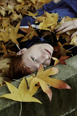 Giovan Battista D'Achille MAN WITH RED HAIR LYING IN AUTUMN LEAVES Men