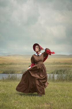Joanna Czogala WOMAN WITH BONNET RUNNING IN FIELD BY RIVER Women