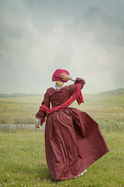 Joanna Czogala WOMAN WITH BONNET IN FIELD BY RIVER Women
