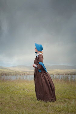 Joanna Czogala WOMAN WITH BONNET IN FIELD BY RIVER Women