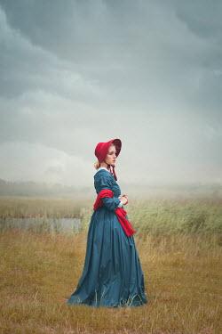 Joanna Czogala WOMAN WITH BONNET AND SHAWL IN FIELD BY LAKE Women
