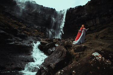 Katerina Klio WOMAN WITH RED HAIR AND CAPE BY WATERFALL Women
