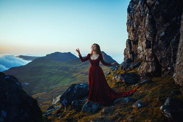 Katerina Klio WOMAN IN RED DRESS STANDING ON MOUNTAIN Women