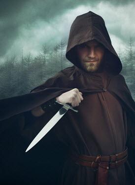 Mark Owen MAN IN HOOD HOLDING KNIFE IN COUNTRYSIDE Men