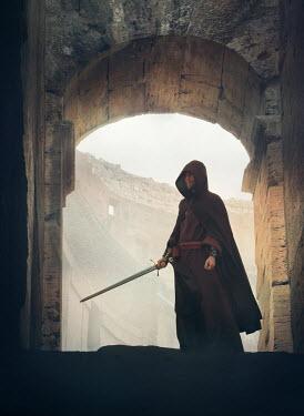 Mark Owen MAN IN CAPE HOLDING SWORD IN ARCHWAY Women