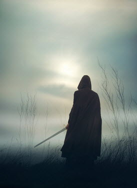Mark Owen MAN IN CAPE HOLDING SWORD IN FOGGY FIELD Men