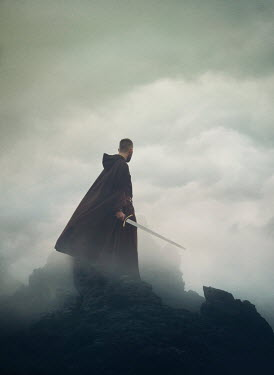Mark Owen MAN IN CAPE HOLDING SWORD ON FOGGY CLIFF Men