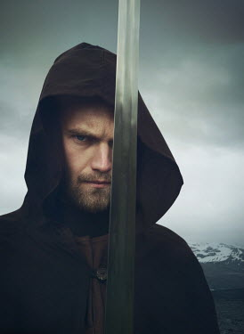 Mark Owen MAN IN CAPE HOLDING SWORD OUTDOORS IN WINTER Men