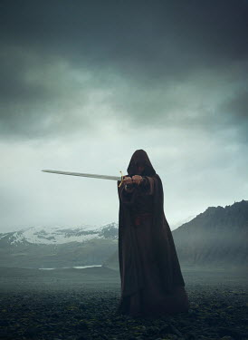 Mark Owen MAN IN CAPE HOLDING SWORD WITH SNOWY MOUNTAINS Men