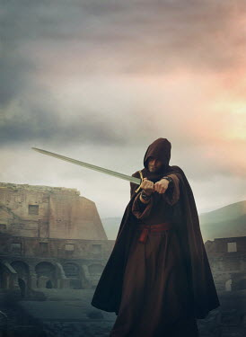 Mark Owen MAN IN CAPE HOLDING SWORD IN AMPHITHEATRE Men