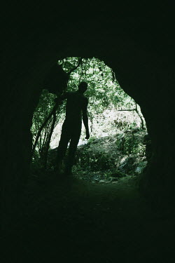 Giovan Battista D'Achille SILHOUETTED MAN STANDING BY CAVE Men