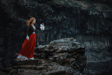 Katerina Klio WOMAN WITH LANTERN ON CLIFF AT DUSK Women
