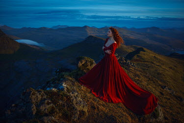 Katerina Klio WOMAN IN RED WITH MOUNTAINS AT DUSK Women