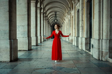 Katerina Klio WOMAN IN RED STANDING IN GRAND COLONNADE Women