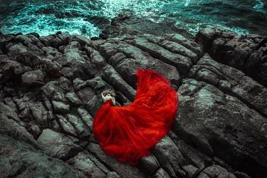 Katerina Klio WOMAN IN RED LYING ON CLIFFS BY SEA Women