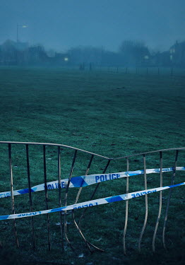 Lyn Randle BENT METAL FENCE WITH POLICE TAPE AT DUSK Miscellaneous Objects