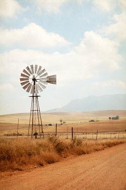 Miguel Sobreira WINDMILL BY ROAD IN SUMMERY LANDSCAPE Fields